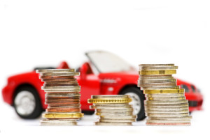 Coin piles over expensive red sport car